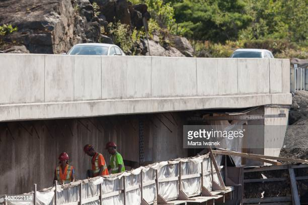 GRAVENHURST ON JULY 31 Construction workers at the Gull Lake Narrows bridge which is soon to be fully open after two years of construction in...