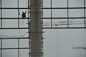 Construction workers at the Harbin airport to build new building in Harbin Heilongjiang province of China on July 20 2016China's overall economic...