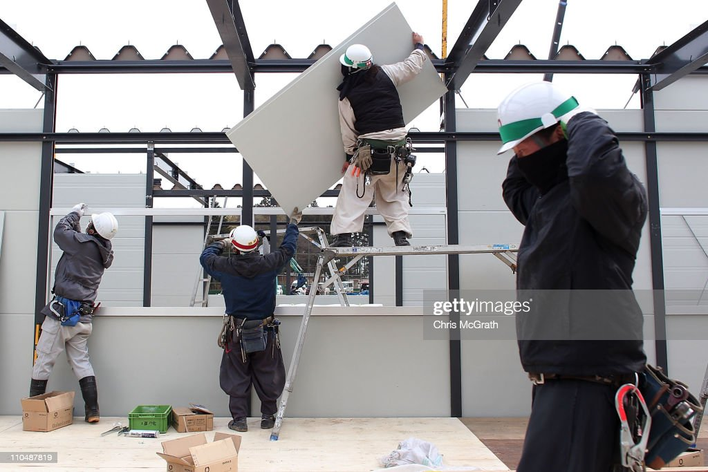 Construction workers build 200 temporary houses on March 20, 2011 in Rikuzentakata, Japan. Many people have begun to return to their homes as the search continues for thousands still missing after a 9.0 magnitude strong earthquake struck on March 11 off the coast of north-eastern Japan. The quake triggered a tsunami wave of up to 10 metres which engulfed large parts of north-eastern Japan.