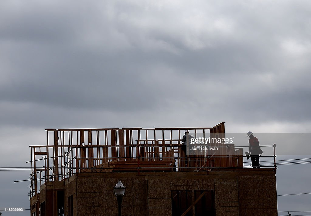 Construction workers build a new home at the Arbor Rose housing development on July 18, 2012 in San Mateo, California. The Commerce Department reported that housing starts surged 6.9% in June, the highest increase since October 2008.