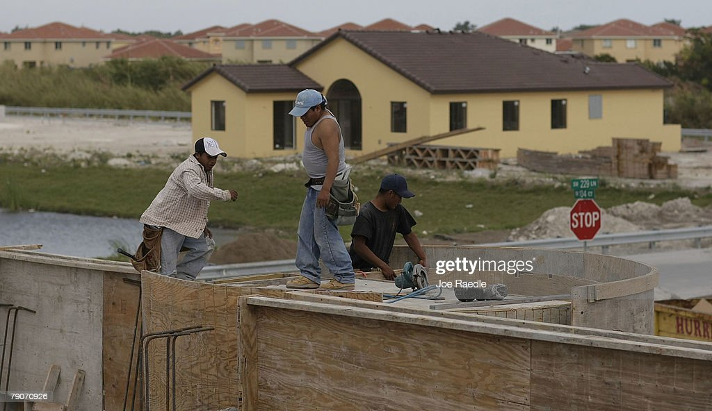 Construction workers build a new home January 17, 2008 in Miami, Florida. The Commerce Department released figures showing that new home construction is down 24.8 percent from 2006.