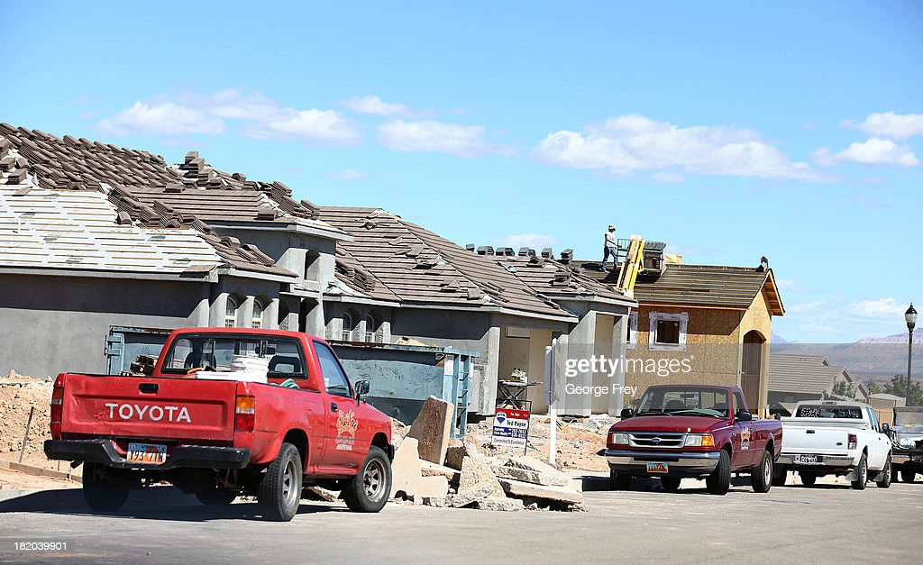 Construction workers build a single family home September 27, 2013 in St. George, Utah. Housing starts on single-family rose at a faster pace in August, and building permits rose to a five-year high, according to published reports this week.