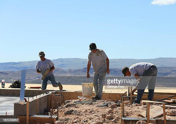 Construction workers build a single family home September 27 2013 in St George Utah Housing starts on singlefamily rose at a faster pace in August...