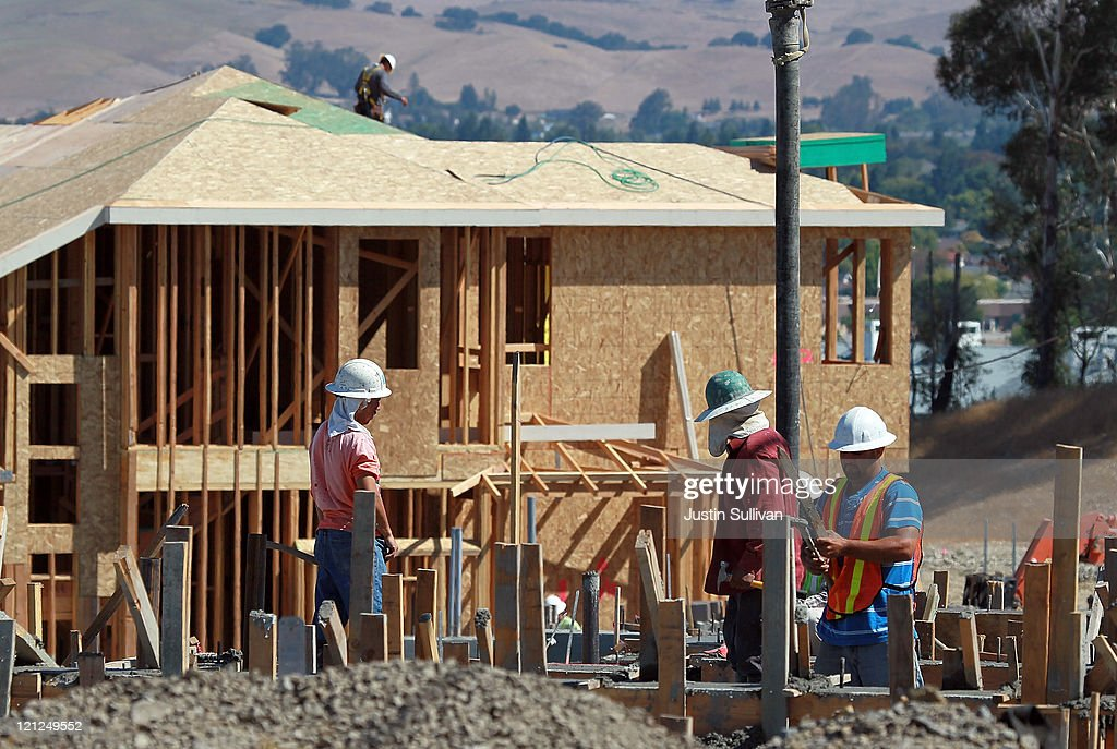 Construction workers build new homes at a new housing development on August 16, 2011 in Petaluma, California. The Commerce Department reported that new home construction fell in July with homebuilders beginning construction on a seasonally adjusted 604,000 homes for the month, a 1.5 percent decline from June.