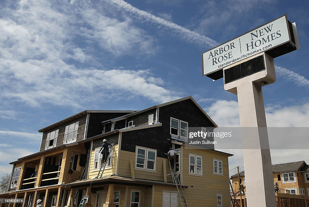 Construction workers build new homes at the Arbor Rose housing development on March 20, 2012 in San Mateo, California. The Commerce Department reported today that new building permits rose 5.1 percent in February, the highest since October 2008.