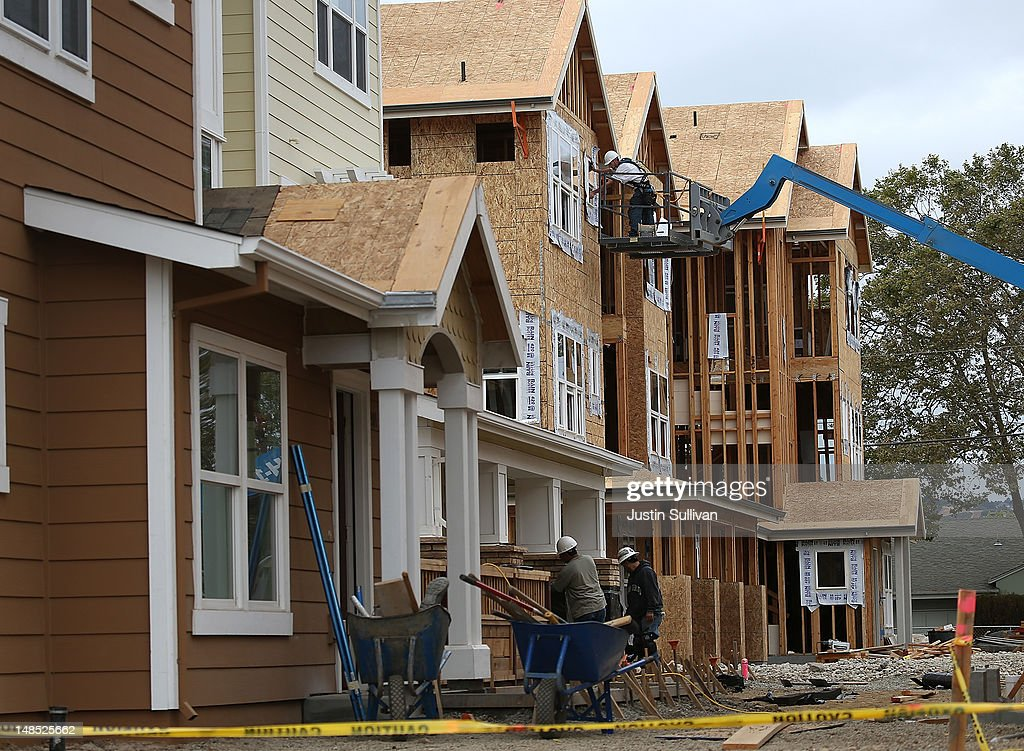 Construction workers build new homes at the Arbor Rose housing development on July 18, 2012 in San Mateo, California. The Commerce Department reported that housing starts surged 6.9% in June, the highest increase since October 2008.