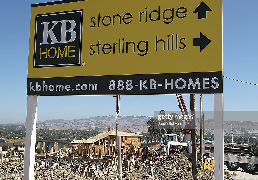Construction workers build new homes near a sign at a new housing development on August 16, 2011 in Petaluma, California. The Commerce Department reported that new home construction fell in July with homebuilders beginning construction on a seasonally adjusted 604,000 homes for the month, a 1.5 percent decline from June.