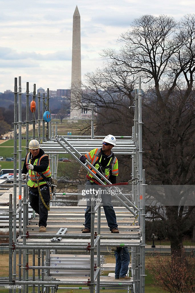 Construction workers build the Inaugural platform December 11, 2012 on Capitol Hill in Washington, DC. President Barack Obama will be sworn in for his second term as the President of the United States during a private ceremony on January 20 and a public ceremony on January 21, 2013.