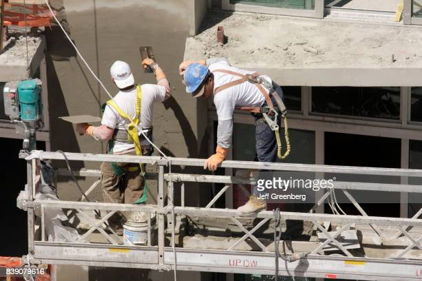 A construction workers building concrete walls on Ocean Drive