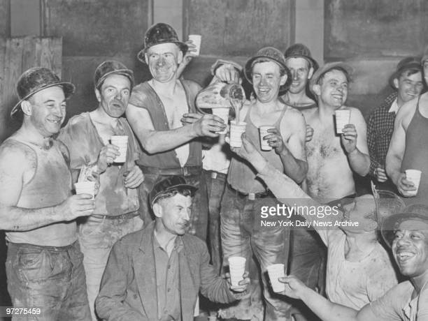 Construction workers celebrate the holing through of the last connecting link for the Sixth Avenue subway between 8th and 53rd Streets