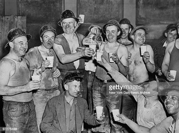 Construction workers celebrate the holing through of the last connecting link for the Sixth Avenue Subway between Eighth and 53rd Streets