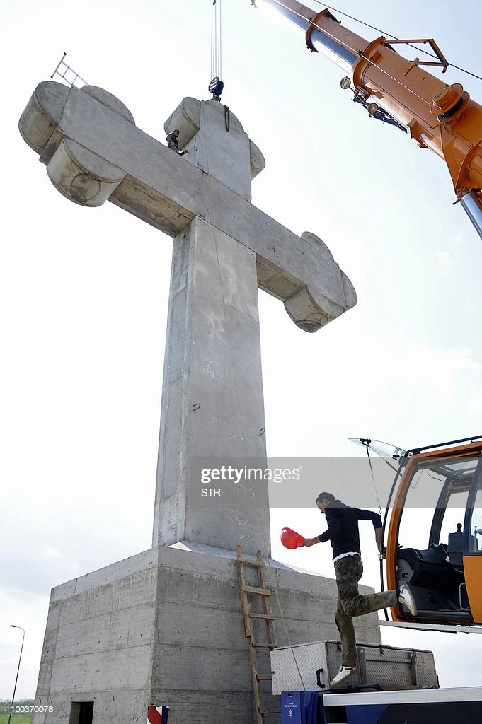 Construction workers complete the 18 meters high Orthodox cross at the entrance to the Serbian city of Kragujevac, 100 kilometers south of capital Belgrade on May 24,2010. City officials decided to build the monumental concrete cross as new landmark of the city.