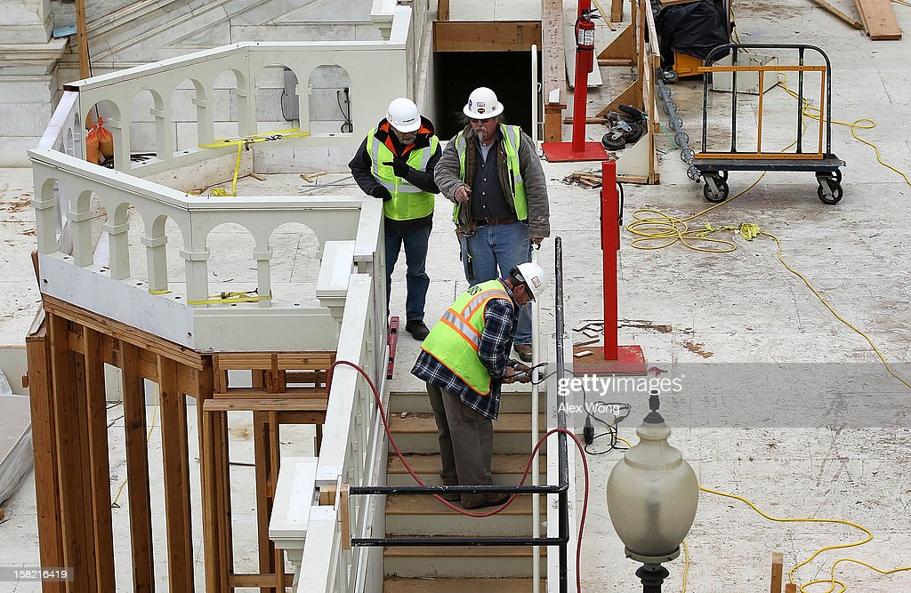 Construction workers continue to build the Inaugural platform December 11, 2012 on Capitol Hill in Washington, DC. President Barack Obama will be sworn in for his second term as the President of the United States during a private ceremony on January 20 and a public ceremony on January 21, 2013.