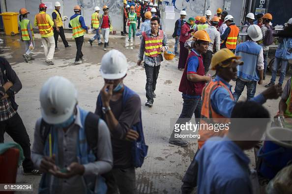Construction workers exit a building site in Phnom Penh Cambodia on Monday Oct 24 2016 Cambodia has a population of about 16 million people and gross...