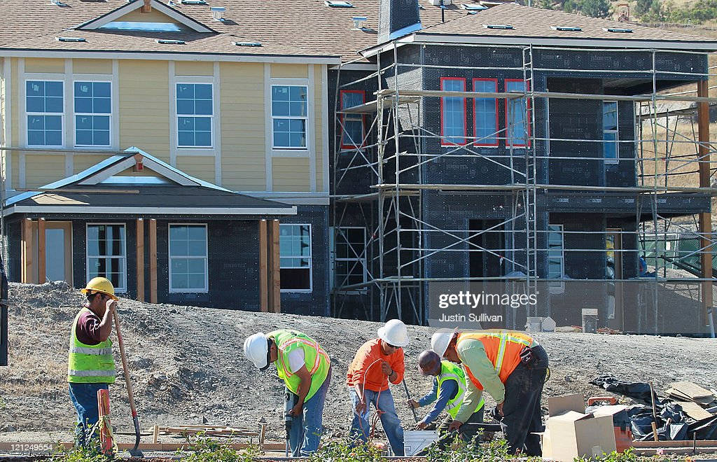 Construction workers fix a walkway at a new housing development on August 16, 2011 in Petaluma, California. The Commerce Department reported that new home construction fell in July with homebuilders beginning construction on a seasonally adjusted 604,000 homes for the month, a 1.5 percent decline from June.
