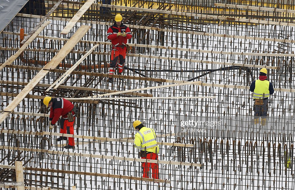 Construction workers fix the roof of the new Vienna central railway station on January 21, 2013 in Vienna, Austria.