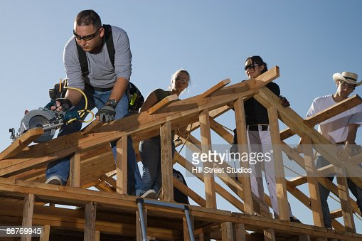 Construction workers framing house : Stock Photo