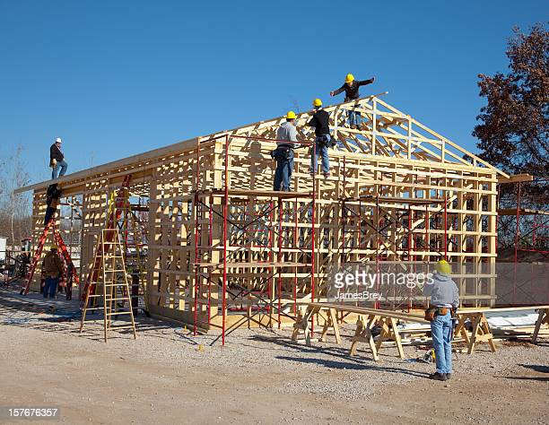 Construction Workers Framing-In Building