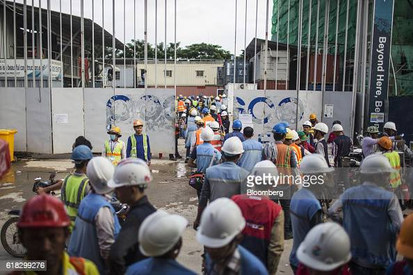 Construction workers gather outside of a building site in Phnom Penh Cambodia on Monday Oct 24 2016 Cambodia has a population of about 16 million...