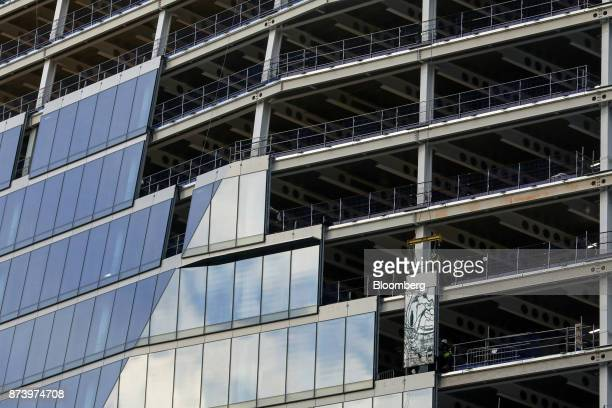 A construction workers glaze commercial building 100 Bishopsgate in the City of London UK on Monday Nov 13 2017 Investors spent 125 billion pounds on...