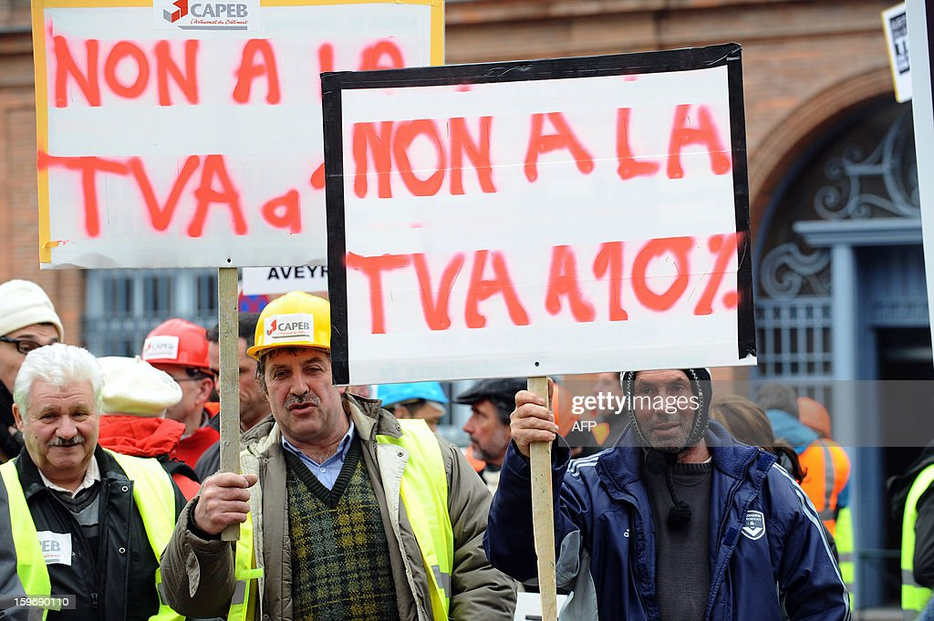 Construction workers hold signs reading ''No to the VAT at 10%' during a demonstration called by the CAPEB, a French union for small-sized craft enterprises, to denounce the increase of the rate of the value added tax (VAT) from seven to ten percent, on January 18, 2013 in Toulouse. Under plans designed to boost the country's competitiveness, the Socialist administration announced 20 billion euros of tax breaks for businesses that will be partly financed by increases in VAT from January 1, 2014.