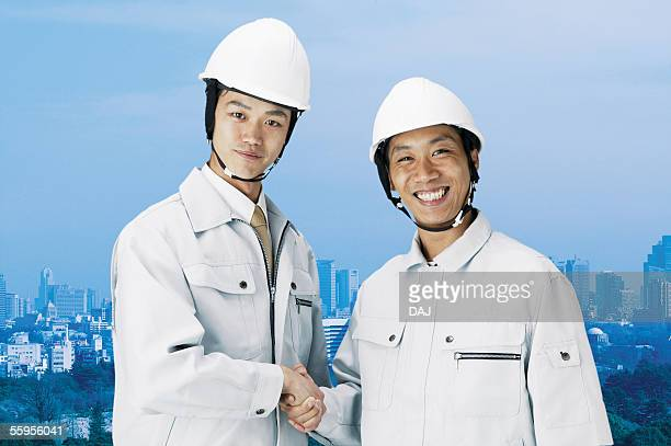 Construction Workers Holding Hands