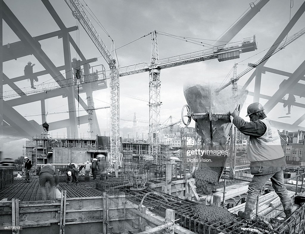 Construction workers in action : Stock Photo