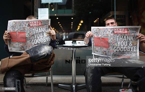 Construction workers James Burton and Stuart Kirk pose with their copies of the least ever News of the World at a cafe in central Manchester on July...