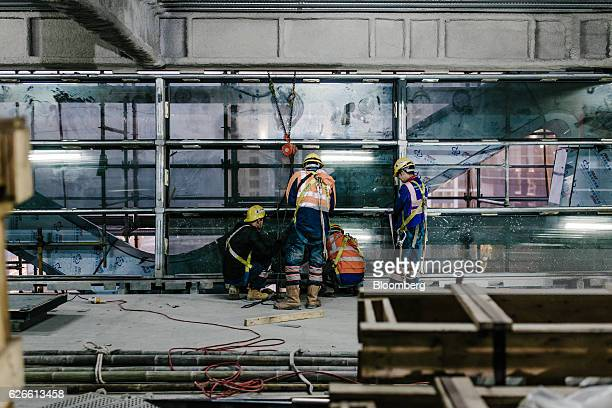 Construction workers labor inside Morpheus Melco Crown Entertainment Ltd's new hotel tower under construction at the company's City of Dreams casino...