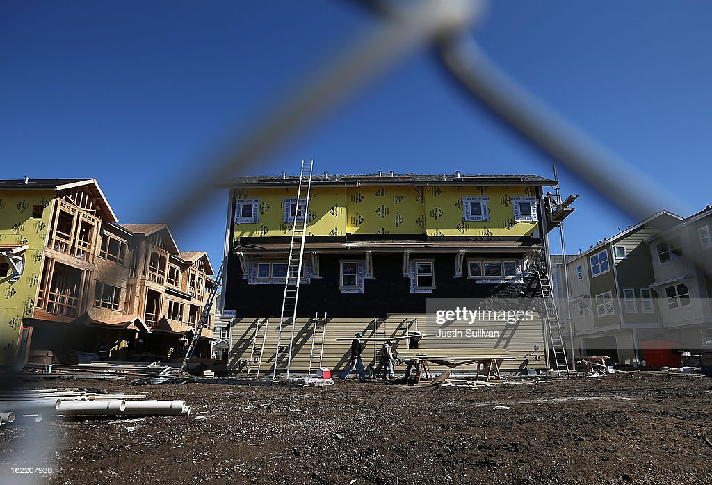 Construction workers move a stack of lumber at the Arbor Rose housing development on February 20, 2013 in San Mateo, California. The Commerce Department reported that new housing starts dropped 8.5% in January following a 15.7% increase one month earlier.