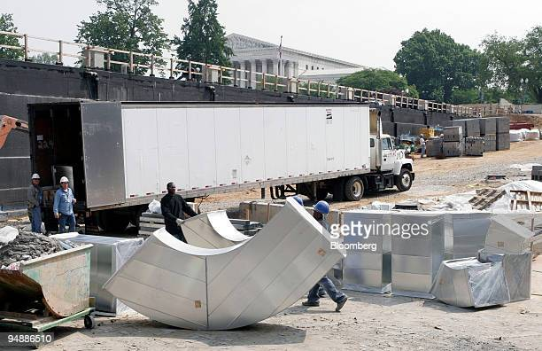 Construction workers move air conditioning ducts at the new Capitol Visitors Center on the east front of the US Capitol Wednesday May 18 2005 in...