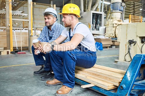 Construction Workers on Coffee Break : Stock Photo
