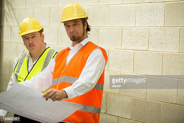 Construction Workers or Engineers With Plans