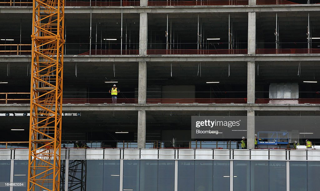 A construction workers oversees construction at a new Royal Dutch Shell Plc., building under construction in Houston, Texas, U.S., on Monday, March 18, 2013. Office sales in Houston, the fourth-largest U.S. city, jumped 32 percent last year to $3.89 billion, the highest total in five years and outpacing the 21 percent gain for the entire U.S., according to the research firm Real Capital Analytics. Photographer: Aaron M. Sprecher/Bloomberg via Getty Images