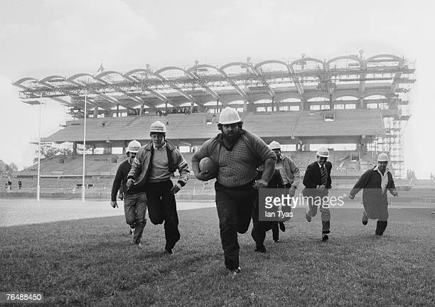 Construction workers playing rugby after the topping out ceremony to mark the completion of the South Stand at Twickenham Stadium west London 13th...