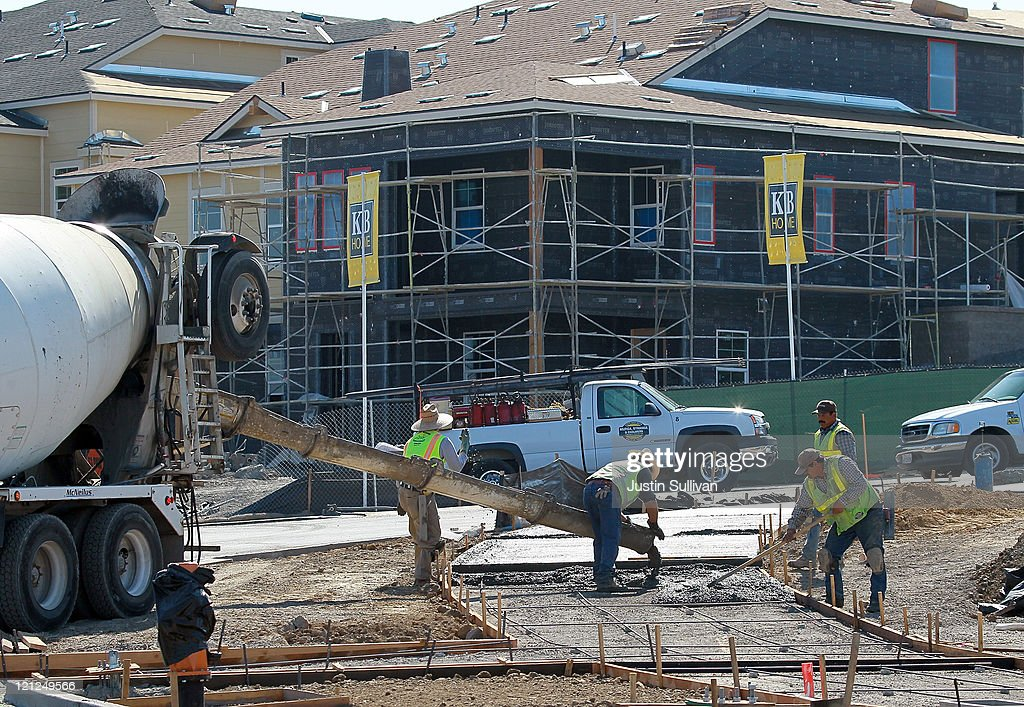 Construction workers pour concrete for a walkway at a new housing development on August 16, 2011 in Petaluma, California. The Commerce Department reported that new home construction fell in July with homebuilders beginning construction on a seasonally adjusted 604,000 homes for the month, a 1.5 percent decline from June.