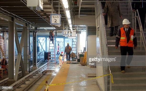 Construction workers rebuild the World Trade Center PATH rail station October 30 2003 in New York City The station which was destroyed in the...