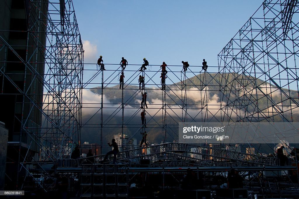 Construction Workers Setting Up Concert Stage