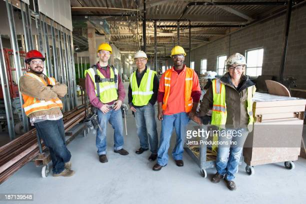 Construction workers smiling at construction site