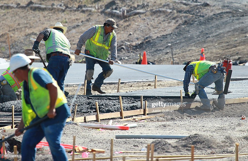 Construction workers smooth concrete for a walkway at a new housing development on August 16, 2011 in Petaluma, California. The Commerce Department reported that new home construction fell in July with homebuilders beginning construction on a seasonally adjusted 604,000 homes for the month, a 1.5 percent decline from June.