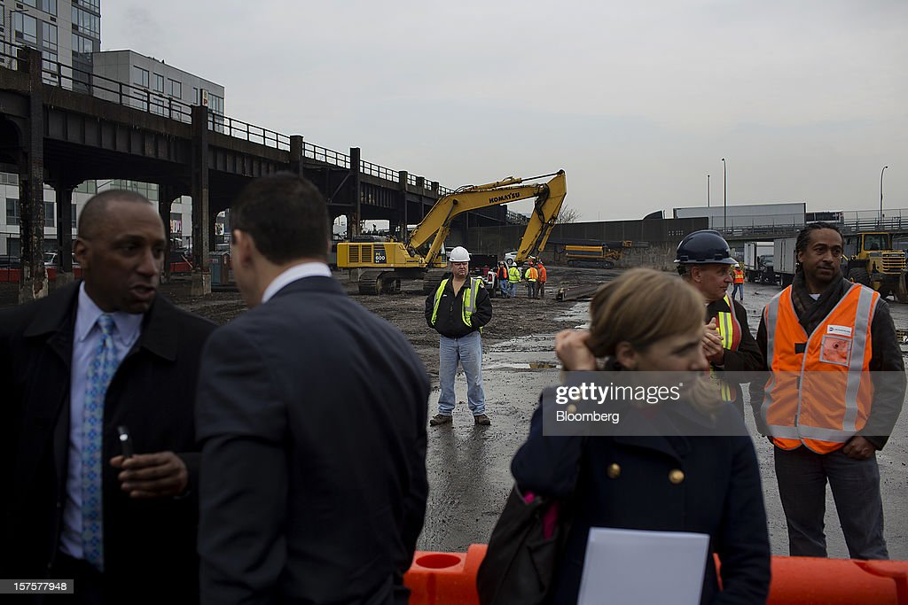 Construction workers stand as attendees gather for the start of the groundbreaking ceremony for the Hudson Yards development in New York, U.S., on Tuesday, Dec. 4, 2012. Related Cos. has tentative deals in place for two more tenants to occupy the first tower of its Hudson Yards development, Chairman Stephen Ross said today as construction began at the 26-acre site on Manhattan's west side. Photographer: Victor J. Blue/Bloomberg via Getty Images