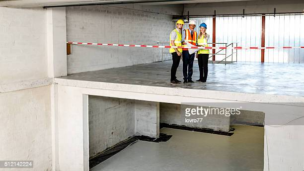 Construction workers standing and looking partitions