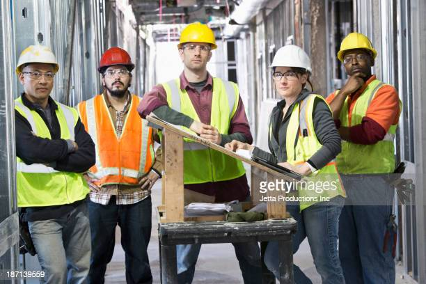 Construction workers standing at construction site