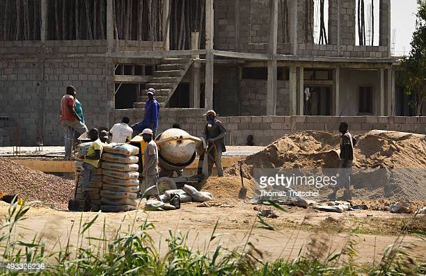 Construction workers standing on the construction site of a house on September 27 2015 in Beira Mozambique