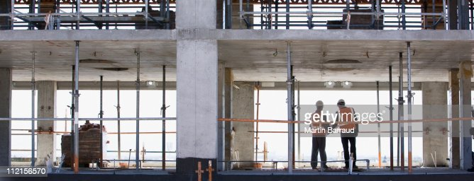 Construction workers standing together on construction site