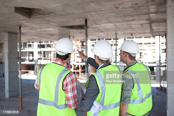 Construction workers talking on construction site