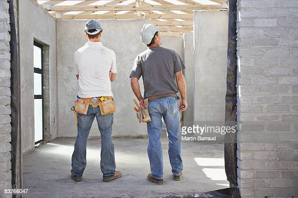 Construction workers viewing construction site