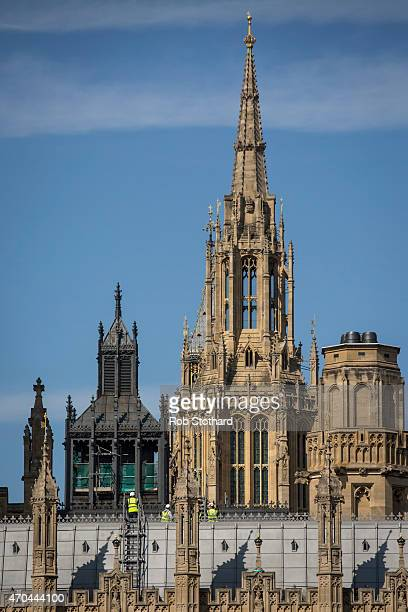 Construction workers walk on the roof of the Houses of Parliament on April 20 2015 in London England John Bercow the Speaker of the House of Commons...