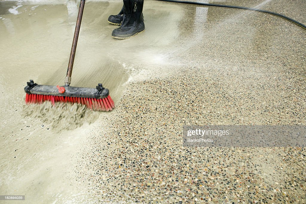 Construction Workers Washing Concrete Patio To Expose Aggregate : Stock  Photo