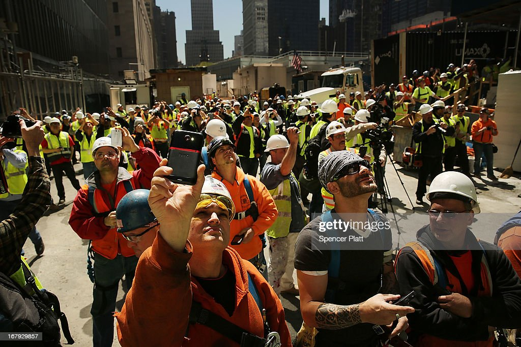 Construction workers watch as the final two sections of the last 75-foot section of the 408-foot spire are placed on a temporary platform on the top of One World Trade Center on May 2, 2013 in New York City. When bolted into place at a later date, the spire will make One World Trade Center the tallest building in the Western Hemisphere.The raising of the spire, which comes on the second anniversary of the death of Osama bin Laden, will make One World Trade Center 1,776 feet tall. One World Trade Center is built on the site where the September 11, 2001 attacks toppled the original World Trade Center towers.
